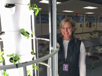 A club donates to help grow tower of food