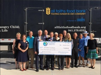 Rotary District presents cheque to food bank for expansion