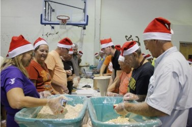 Rotary club packs 144,000 meals in two hours