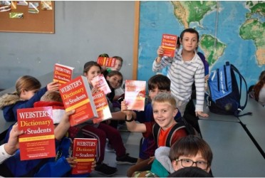 Rotary donates books to elementary schools