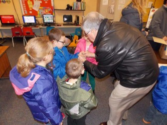 Rotary donates winter jackets to schoolchildren