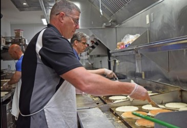 Rotary club flips pancakes into scholarship funds